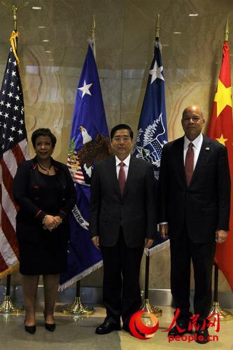 美国司法部部长林奇、国务委员郭声琨、美国国土安全部部长约翰逊。摄影:高石