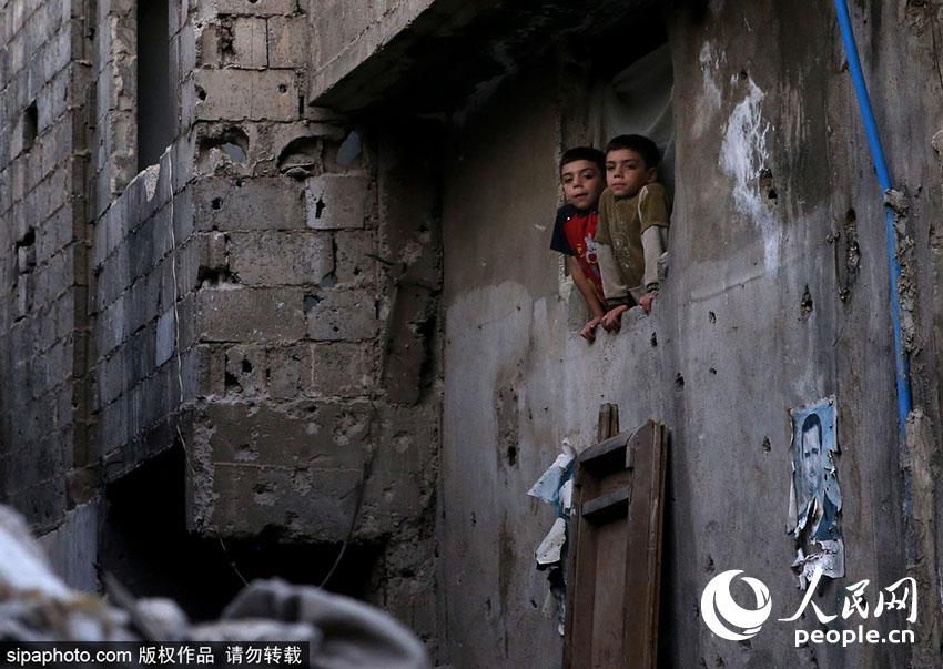 战火笼罩下叙利亚儿童的生活(组图)