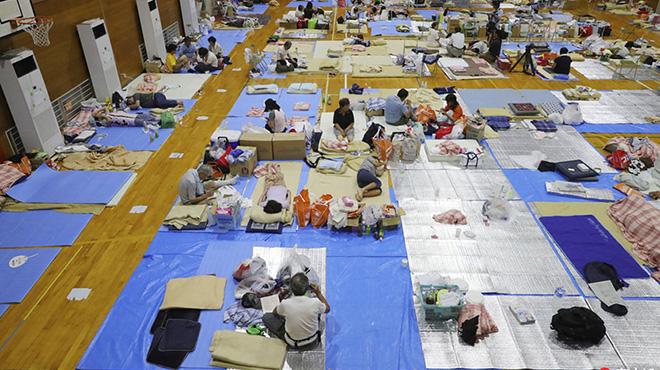 日本暴雨已致200人死亡 灾民体育馆内打地铺避难
