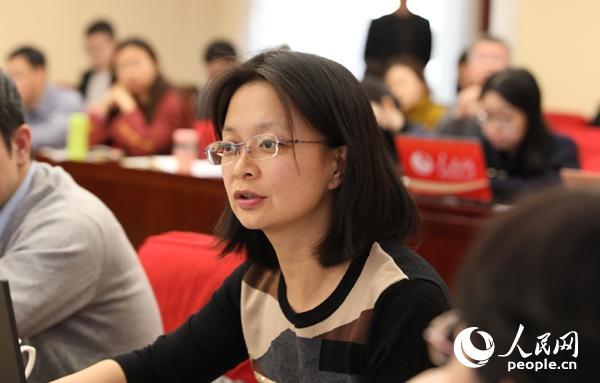 中心党校国际战略钻研院副教授周绍雪在论坛上说话 (贾文婷 摄)