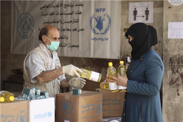受疫情影响世界粮食打算署援助全球饥饿人口数量创新高